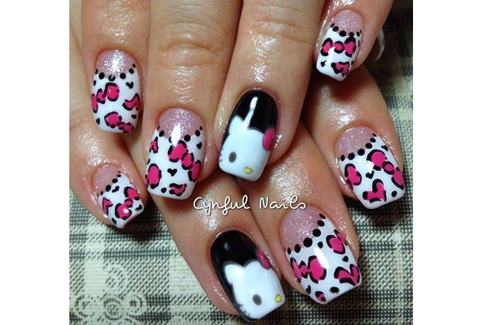 foto de uñas decoradas con estilo hello kitty con moños