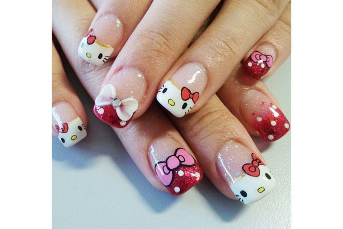 foto de uñas decoradas con estilo hello kitty con moños rosa