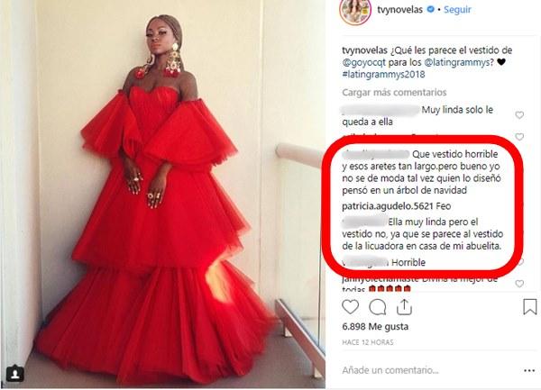 Foto de Goyo en los Premios Grammy Latinos con un vestido rojo