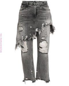 Falda de jean gris sobre pantalón roto de jean