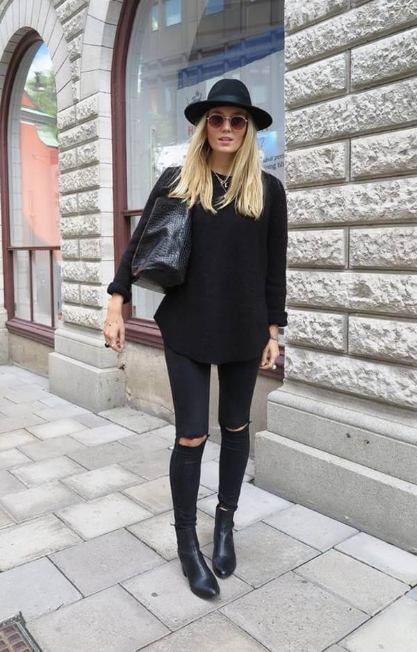 Foto de chica con pantalón negro roto combinado con sombrero de ala ancha