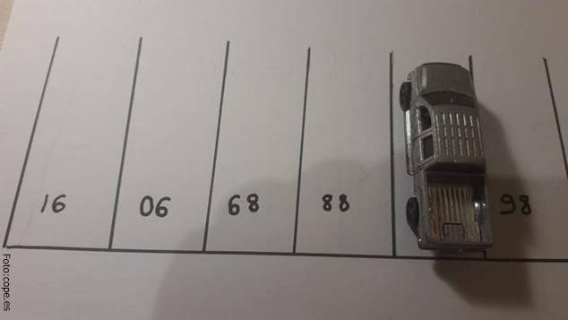 Reto visual del número del parqueadero del carro.