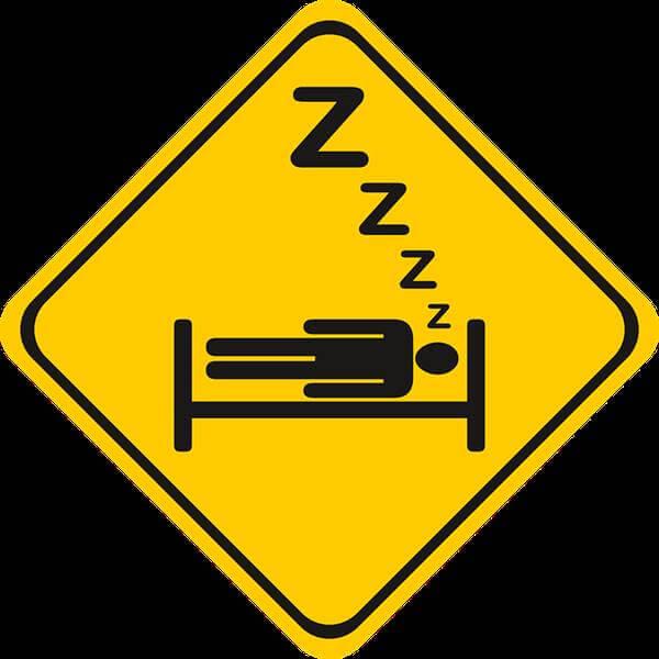 Imagen de señal de tránsito con una persona durmiendo en ella