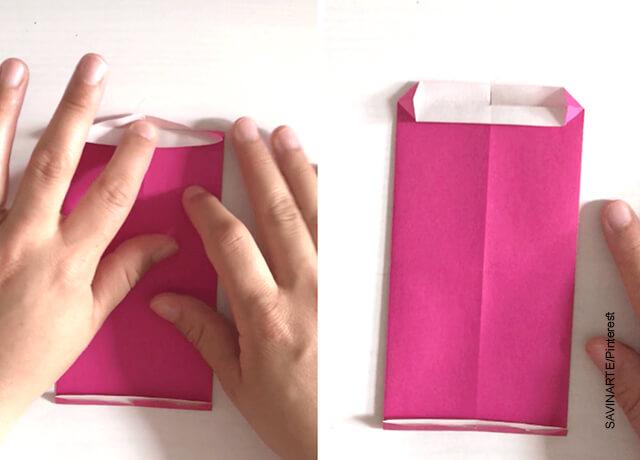 Foto de una hoja de papel en forma de sobre que ilustra cómo hacer un corazón de papel