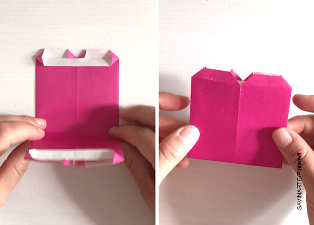 Foto de arte de origami con un papel rosada