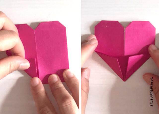 Foto de una mano plegando un papel