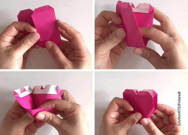 Foto de unas manos formando una figura que revela cómo hacer un corazón de papel