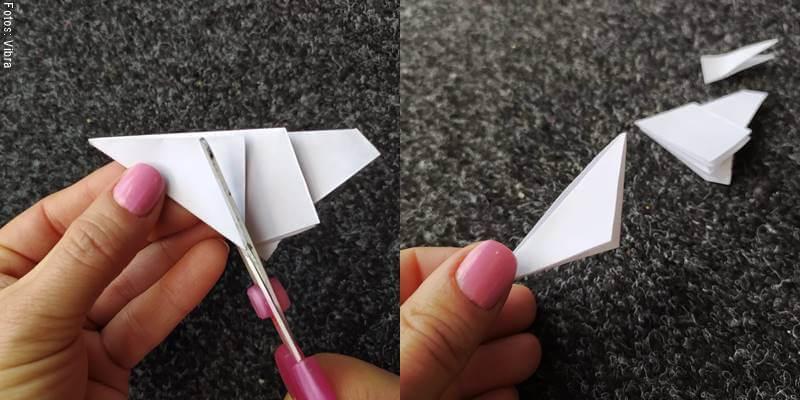 Foto de papel siendo cortado con tijeras