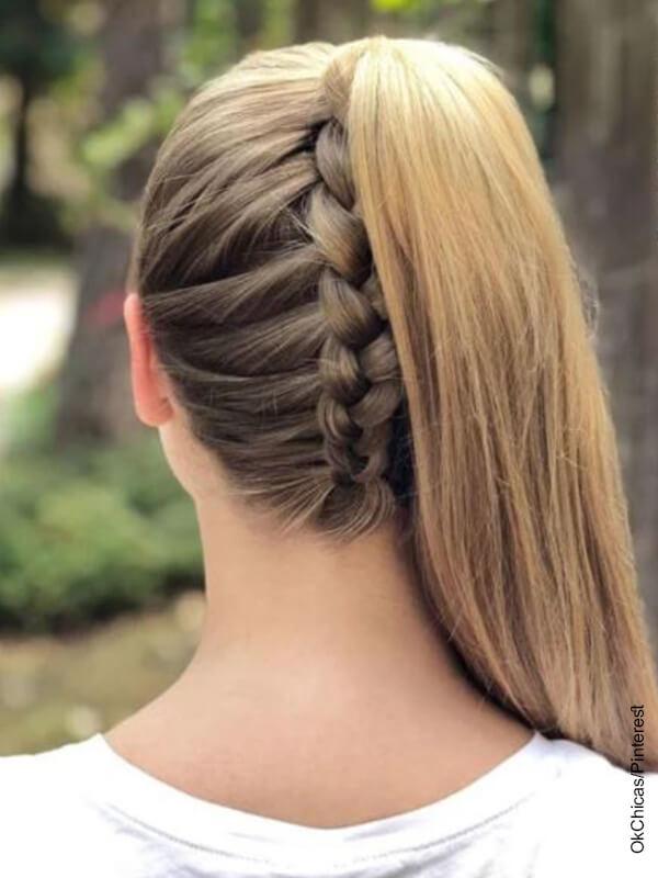 Foto de una chica rubia con trenzas que muestra los peinados con cola alta