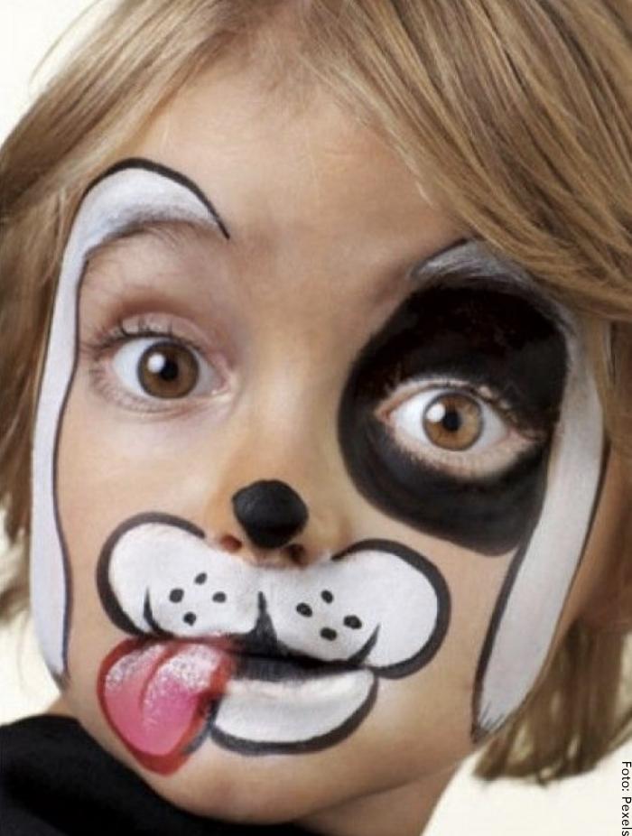 Foto de un niño con maquillaje de cachorrito