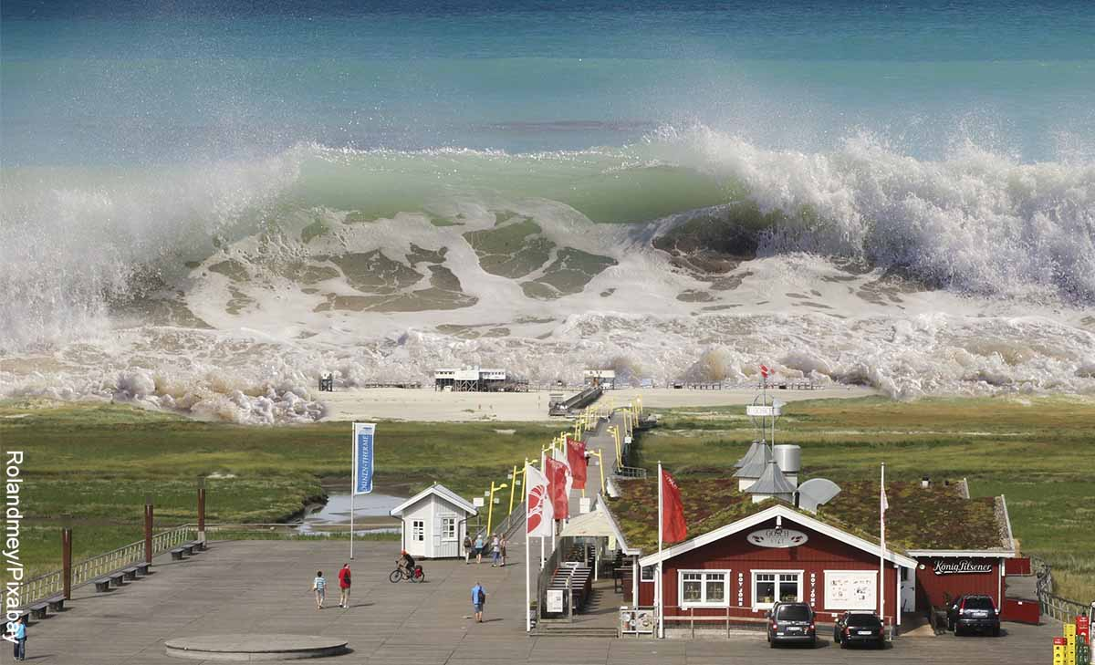 Foto de un pueblo que va a ser arrasado por olas que muestra qué significa soñar con tsunami
