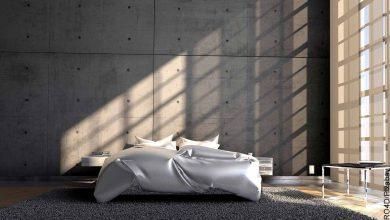 Foto de un cuarto de un apartamento con una cama que revela lo que es soñar con cama