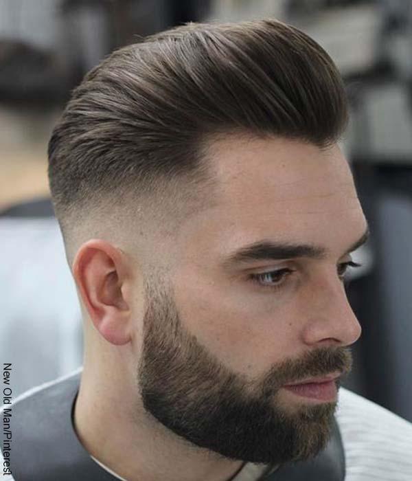 Foto de un hombre con barba y un look de pelo corto