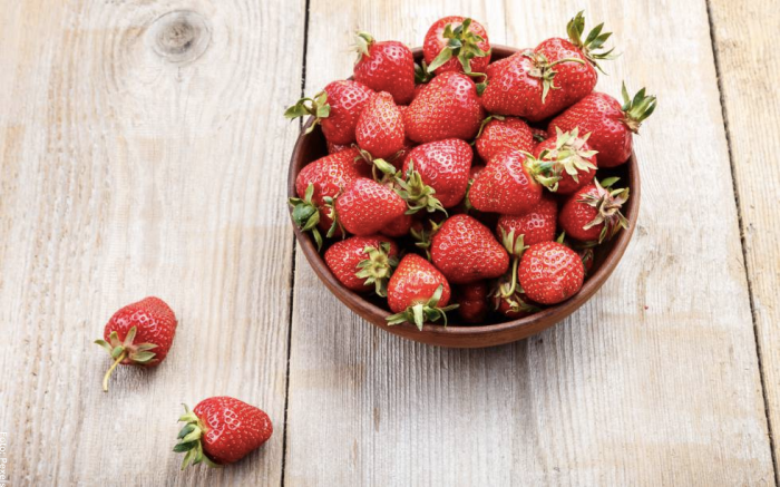 Foto de una taza de fresas