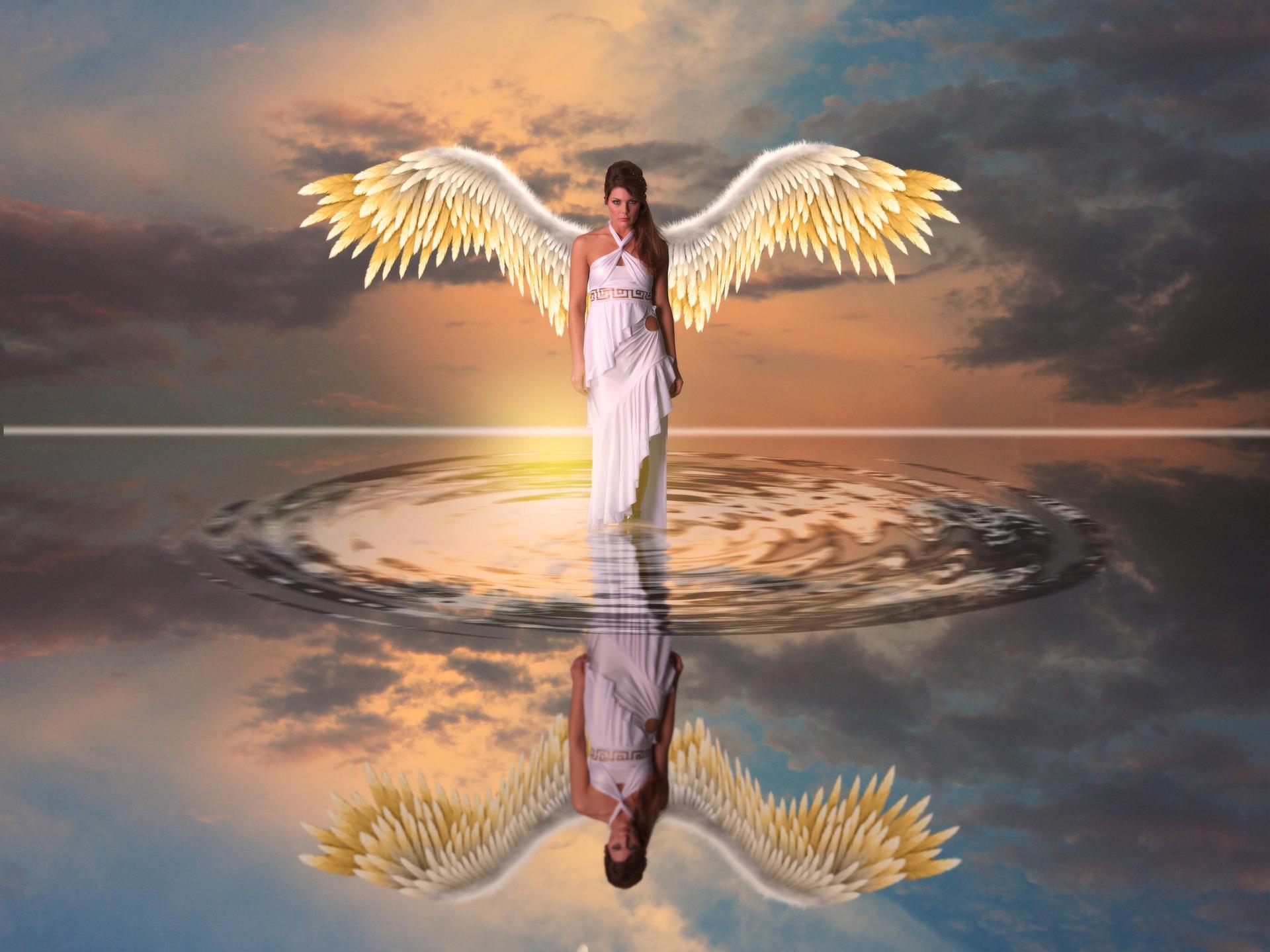 Foto de una mujer con alas de ángel sobre el agua que revela qué significa soñar con ángeles