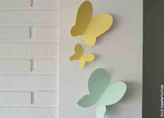 Foto de varias mariposas de papel pegadas en la pared
